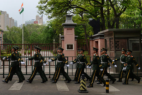Chinese paramilitary police march past the gates of the Indian Embassy in Beijing on May 9, 2013.
