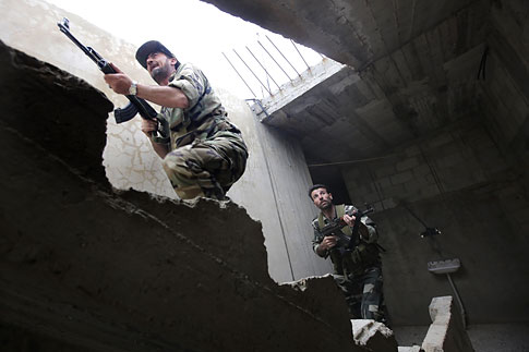 Syrian troops take control of the village of Western Dumayna, some seven kilometers north of the rebel-held city of Qusayr, May 13, 2013.
