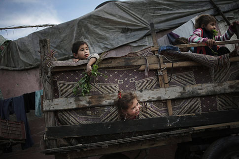 May 16, 2013. Palestinian refugee children play in a poverty-stricken quarter of the town of Beit Lahiya, northern Gaza Strip.