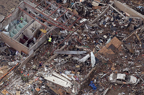 An aerial view shows Plaza Towerss Elementary school in Moore, Okla., Tuesday, May 21, 2013 as rescue workers make their way through the structure.
