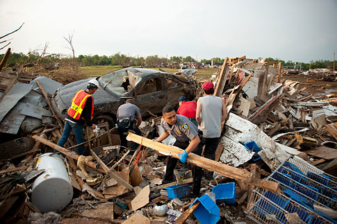 First responders and residents recover amid the aftermath of a deadly tornado in Moore, Okla. on Monday, May 20, 2013.