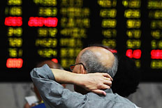 An investor at a trading hall of a securities firm in Shanghai, on June 20, 2013.