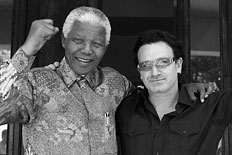 Nelson Mandela and Bono after meeting at Mandela's home in Johannesburg on May 25, 2002.