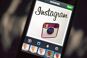 The Instagram logo is displayed on a smartphone on Dec. 20, 2012 in Paris.
