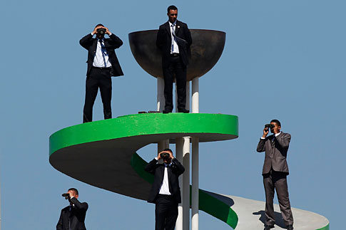 Security guards use binoculars to keep watch during the Algeria Cup final soccer match between CR Belcourt and Entente Setif in Algiers