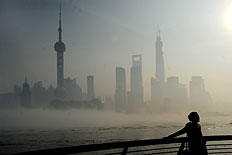 A woman stands at The Bund on December 5, 2013 in Shanghai, China