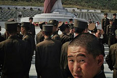 North Korean soldiers gather at a cemetery for military veterans near Pyongyang as they observe Chuseok, Korea's traditional Thanksgiving holiday, September 19, 2013.