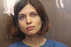From left: Russian feminist punk-rock band Pussy Riot members Maria Alyokhina and Nadezhda Tolokonnikova sit in a glass-walled cage in a court room at the Khamovnichesky Court in Moscow, on Aug. 17, 2012.