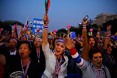 Anti-government protesters shout slogans during a rally at the Democracy Monument in Bangkok, Dec. 8, 2013.