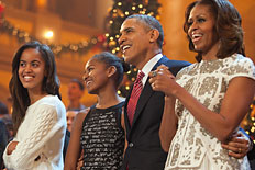 "U.S. President Barack Obama and first lady Michelle Obama, along with daughters Malia and Sasha, sing during the finale of TNT's ""Christmas in Washington"" on Dec. 15, 2013 in Washington, D.C."