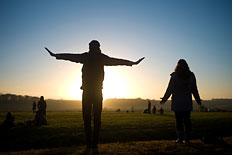 Revellers chant incantations as the sun rises during the winter solstice at Stonehenge on Salisbury Plain in southern England December 21, 2012.