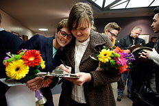 Natalie Dicou, left, and her partner Nicole Christensen wait to get married at the Salt Lake County Clerks office in Salt Lake City, Utah, Dec. 20, 2013.