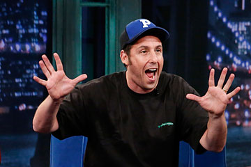 Adam Sandler with host Jimmy Fallon during an interview on July 10, 2013