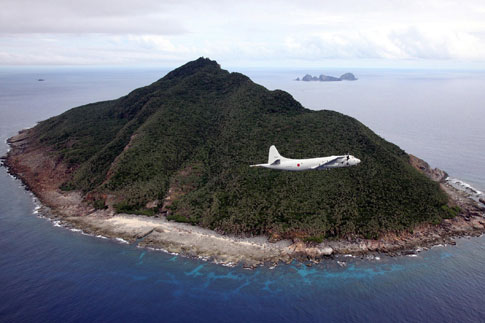 Japanese Maritime Self-Defense Force plane flying over the disputed islets known as the Senkaku islands in Japan and Diaoyu islands in China, in the East China Sea, in 2011.