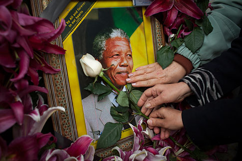 Mourners gathered in front of the South African embassy to pay their respects to the memory of Nelson Mandela on December 7, 2013 in Tehran, Iran.