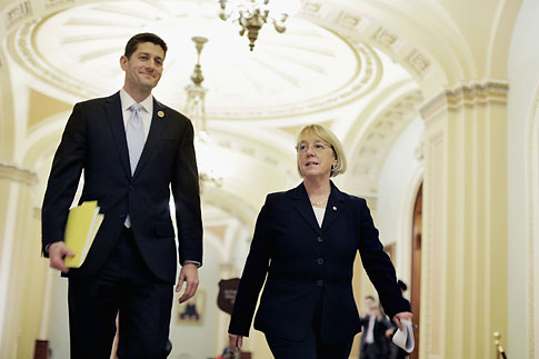 House Budget Committee Chairman Paul Ryan and Senate Budget Committee Chairman Patty Murray walk past the Senate chamber on their way to a press conference at the U.S. Capitol on December 10, 2013 in Washington.