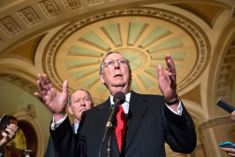 Senate Minority Leader Mitch McConnell of Ky., right, joined by Sen. Lamar Alexander, R-Tenn., speaks at a news conference on Capitol Hill in Washington, Nov. 21, 2013.