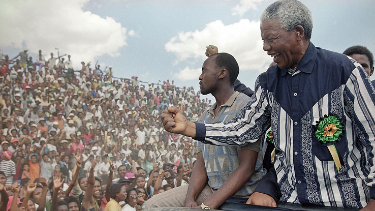 Mandela greets the crowds on the campaign trail in February 1994 as South Africa readies for its first all-race general election.