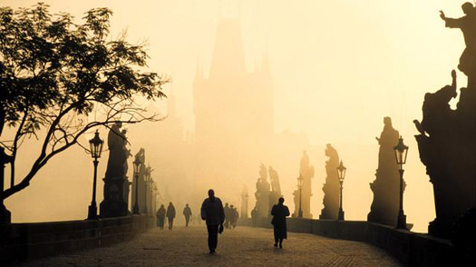Pedestrians walking across the Charles Bridge