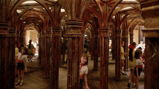 A young girl walks through the Bludiste, a house of mirrors at Petrin Hill park in Prague.