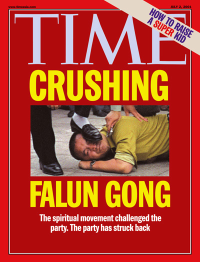 A Chinese Falun Gong supporter is subdued by security officials who handcuff him while one steps on his face