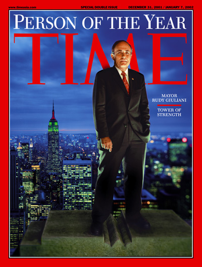 A portrait of Rudy Giuliani on top of a building in New York City.
