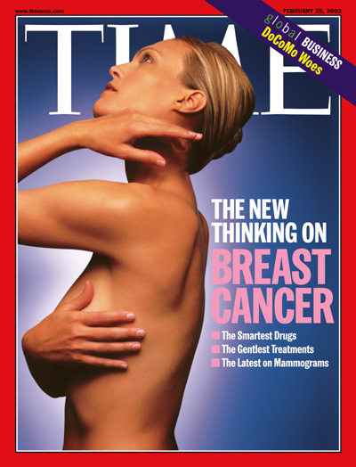 A photo of a woman performing a breast self-exam.