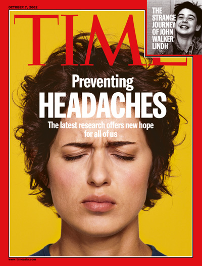 A picture of a woman suffering from a headache.