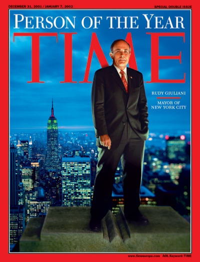 A photo of Rudy Giuliani standing on a roof overlooking New York City.