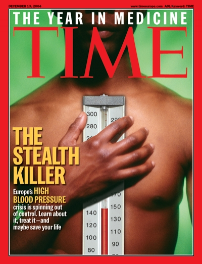 Picture of a man holding a thermometer to his bare chest.