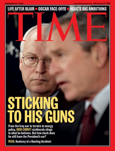 Photo of Dick Cheney looking at George W. Bush.