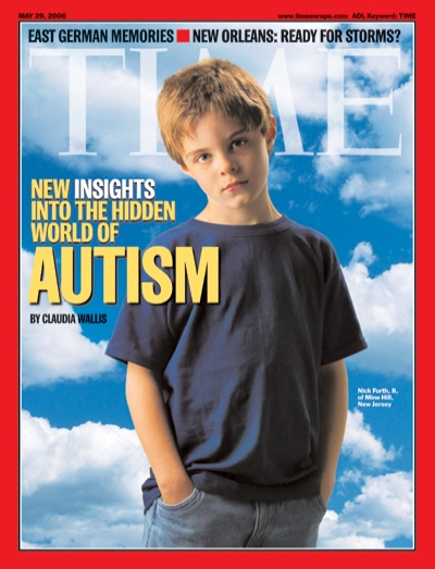 A picture of an autistic boy with a blue sky behind him.