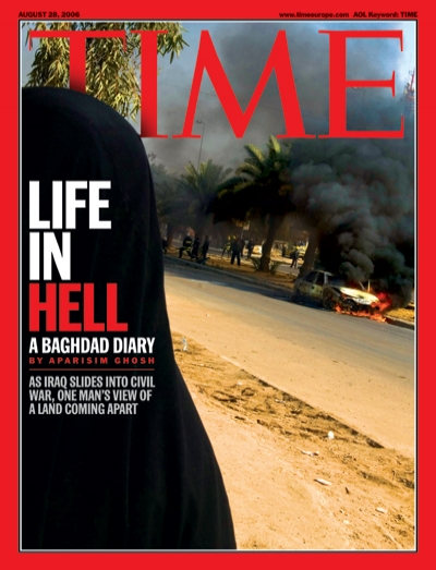 Photograph of an Iraqi woman at the scene of a car bomb.