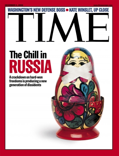 A photo of a matryoshka with duct tape over her mouth.