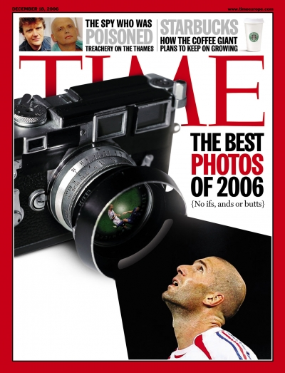 Photograph of Andre Agassi looking into the lens of a well-used Leica camera.