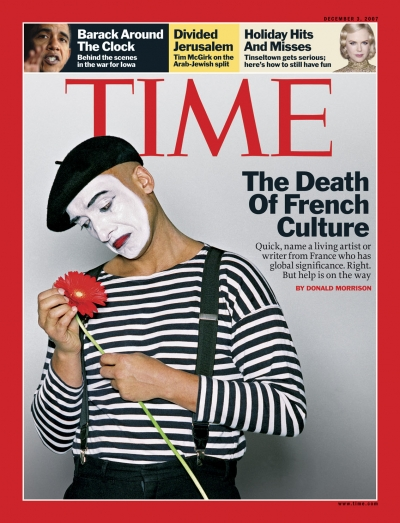 Photo of a sad mime looking at a flower.