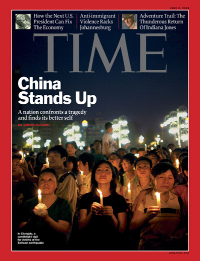 People in China attend a candlelight vigil.