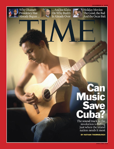 A Cuban man plays a guitar.