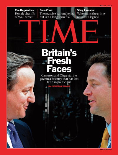 A photo of Nick Clegg and David Cameron talking.