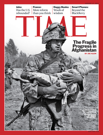 a U.S. soldier carrying a wounded child