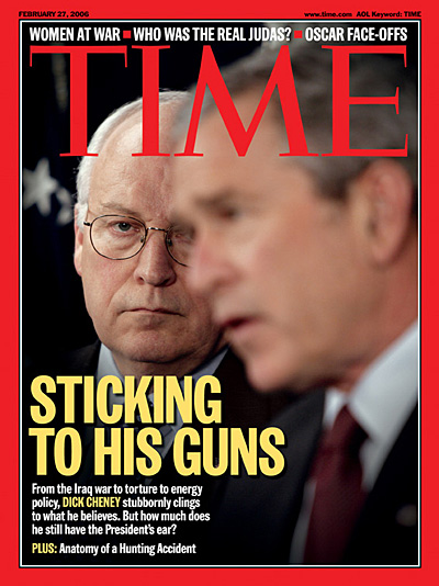 A photo of Dick Cheney watching George W. Bush while he is talking.