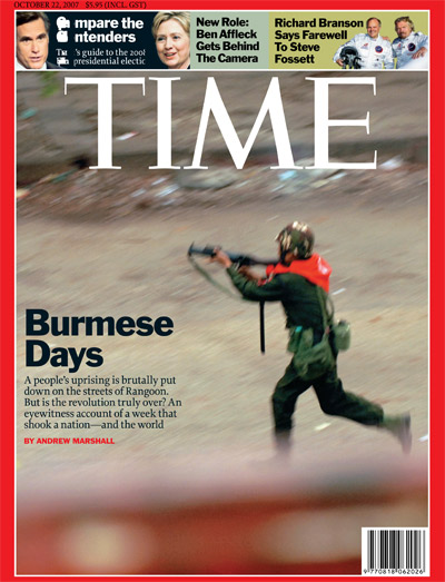 A photo of a Burmese soldier running with a gun.