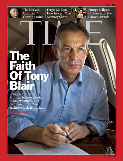 Photo of Tony Blair sitting on an airplane.