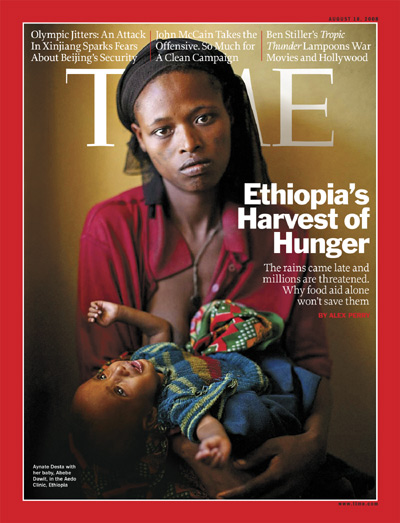 A photo of an Ethiopian woman holding her baby.