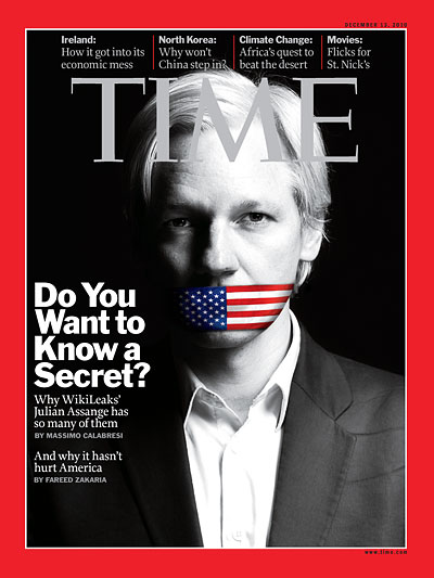 A black and white photo of Julian Assange with his mouth covered by the American flag