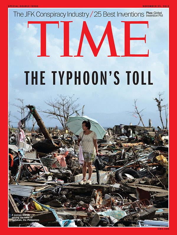 Photo of a woman standing among the ruins of Tacloban, the Philippines