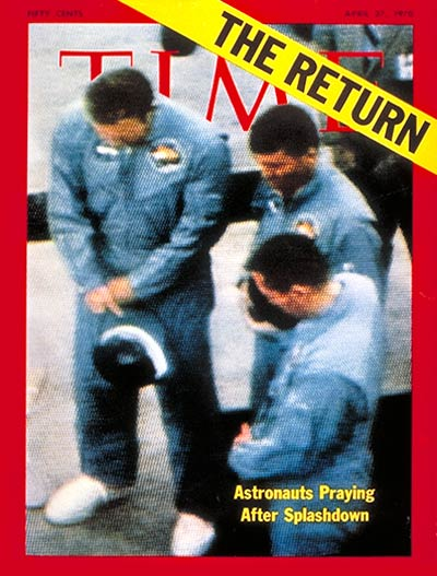 Returning Apollo 13 astronauts, Jim Lovell, Fred Haise and John Swigert praying after splashdown pickup