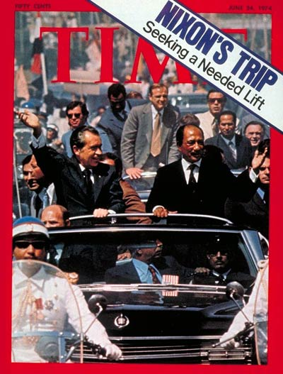 President Nixon in open car with Egyptian Pres. Sadat