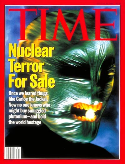 Nuclear Terror for Sale.  Green masked face with glowing sphere in teeth.