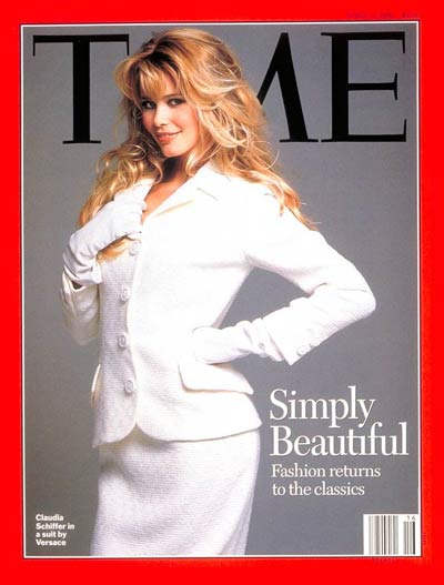 Supermodel Claudia Schiffer wearing a white Gianni Versace suit